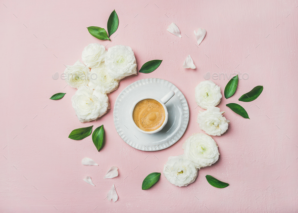 Cup of coffee surrounded with white ranunculus flowers - Stock Photo - Images