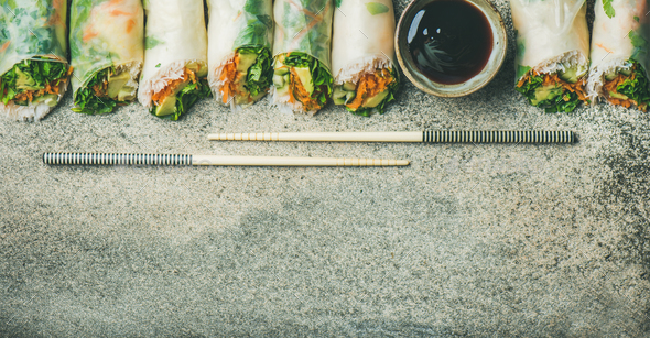 Vegan spring rice paper rolls over concrete background, copy space - Stock Photo - Images