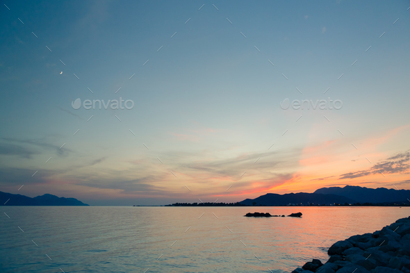Inspirational beautiful sunset landscape at sea and mountains - Stock Photo - Images