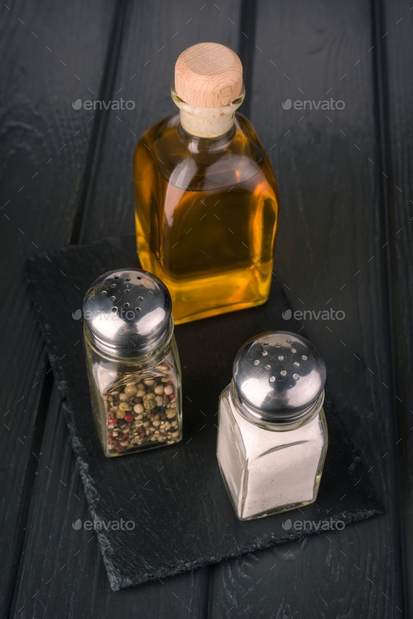 condiments for salad on black wooden board - Stock Photo - Images
