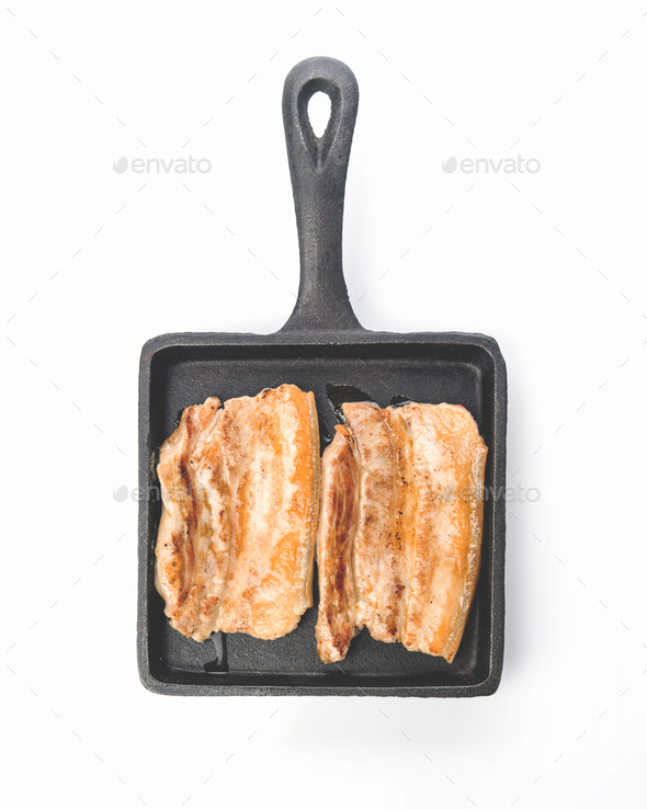 pieces of roasted pork belly on earthenware tray - Stock Photo - Images