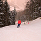 Skiers Racing Down Snowy Mountain With Incredible Red Sunset Sky - VideoHive Item for Sale
