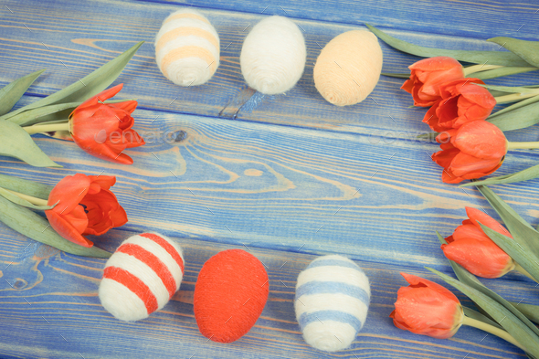 Vintage photo, Easter eggs and fresh red tulips on boards, festive decoration, copy space for text - Stock Photo - Images