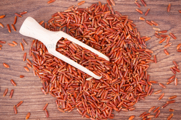 Heap of red rice with scoop, healthy nutrition - Stock Photo - Images