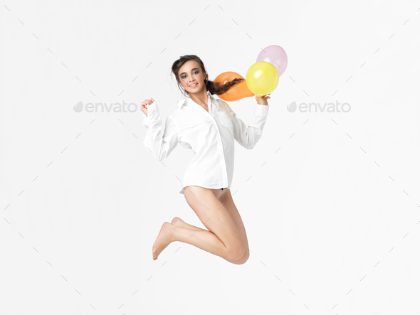 happy woman with balloons, isolated white background - Stock Photo - Images
