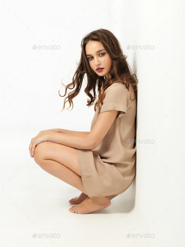 fashion portrait sexy young woman beige dress - Stock Photo - Images