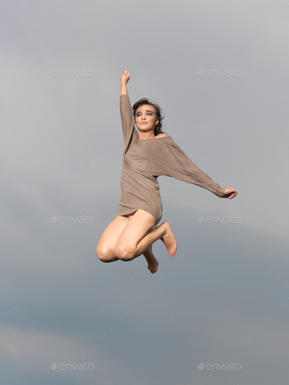 happy, young woman jumping - Stock Photo - Images
