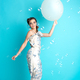 happy woman with balloons on blue background - PhotoDune Item for Sale