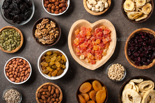 Healthy food. Nuts, dried fruits and seeds - Stock Photo - Images