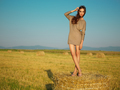 beautiful woman standing on hay stack sunset - PhotoDune Item for Sale
