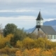 People Are Strolling in a National Icelandic Park in Autumn Day Near Old Building Against Mountain - VideoHive Item for Sale