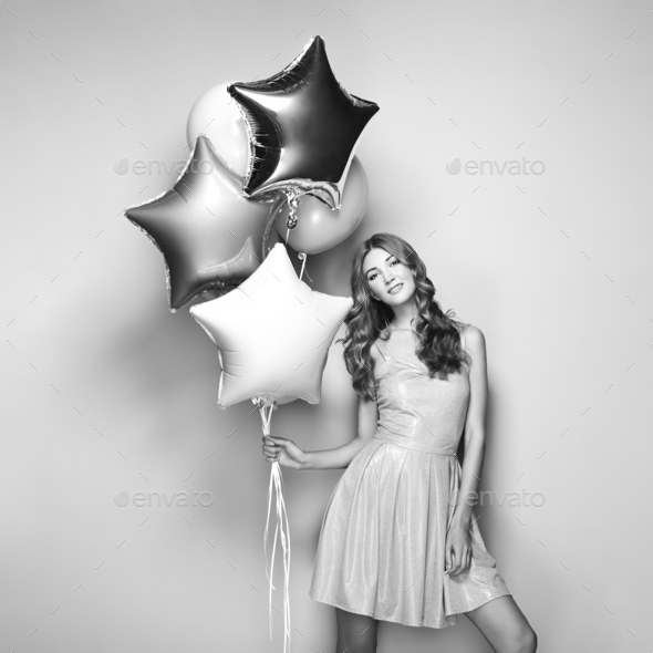 Beautiful young woman with balloons - Stock Photo - Images