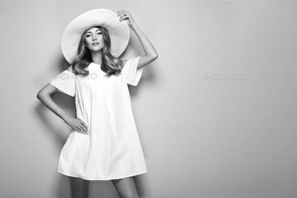 Blonde young woman in elegant white dress - Stock Photo - Images