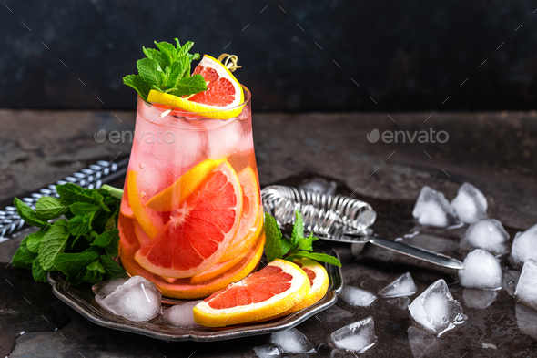 Grapefruit and fresh rosemary gin cocktail with juice - Stock Photo - Images
