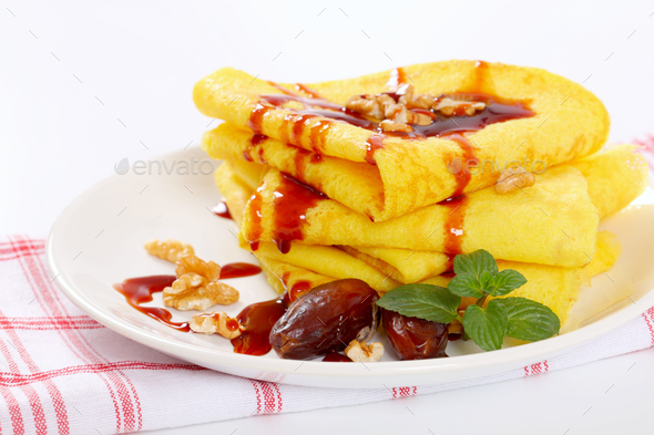 pancakes with walnuts, dates and date syrup - Stock Photo - Images