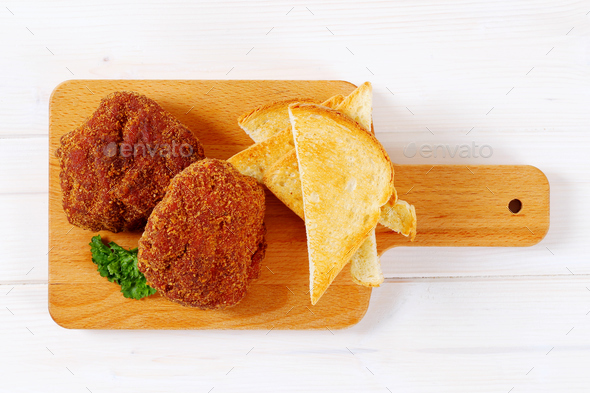 fried burgers with toasted bread - Stock Photo - Images