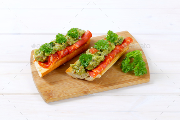 baguettes with salami and guacamole - Stock Photo - Images