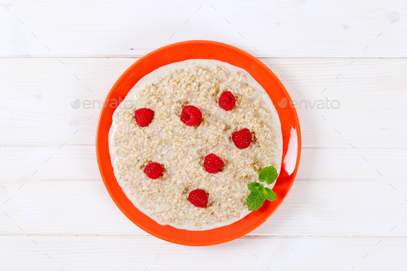 plate of oatmeal porridge - Stock Photo - Images