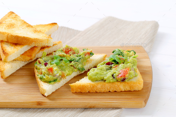 toasted bread with guacamole - Stock Photo - Images