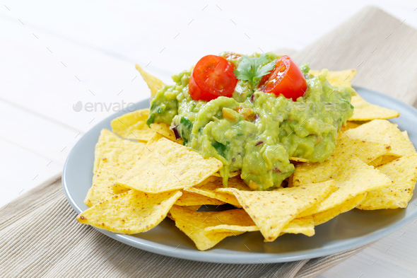 tortilla chips with guacamole - Stock Photo - Images