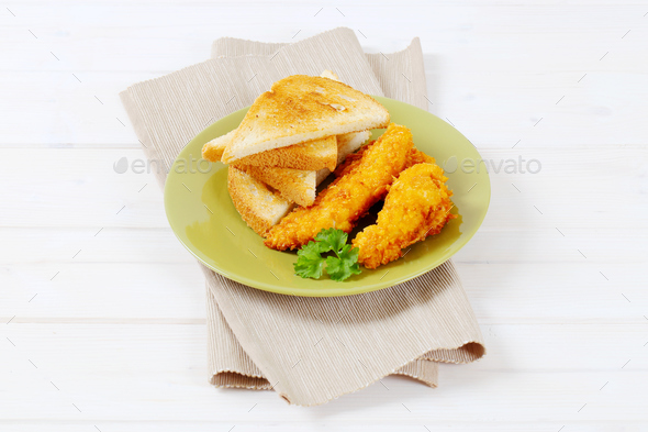 chicken strips with toast - Stock Photo - Images
