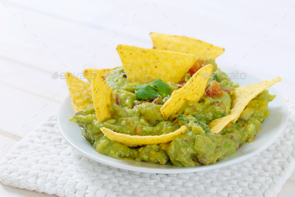 guacamole with tortilla chips - Stock Photo - Images