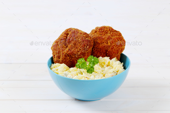 breaded burgers with potato salad - Stock Photo - Images