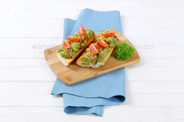 fresh baguettes with guacamole - Stock Photo - Images