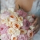 Bride Is Holding a Wedding Bouquet of Roses and Peonies - VideoHive Item for Sale