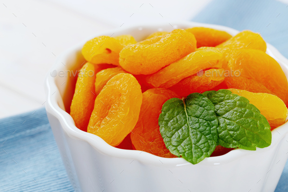 bowl of dried apricots - Stock Photo - Images