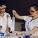 Two Chemists Examine Various Liquids in the Tubes. Experiments in the Laboratory - VideoHive Item for Sale