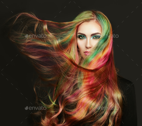 Portrait of young beautiful woman with long flying hair - Stock Photo - Images