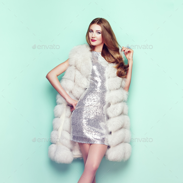 Fashion portrait young woman in white fur coat - Stock Photo - Images