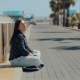 Young Woman Relaxing Sitting on the Road Near Sea - VideoHive Item for Sale