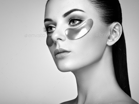 Portrait of Beauty woman with eye patches - Stock Photo - Images
