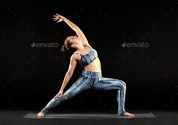 Young woman demonstrating a reverse warrior pose - Stock Photo - Images