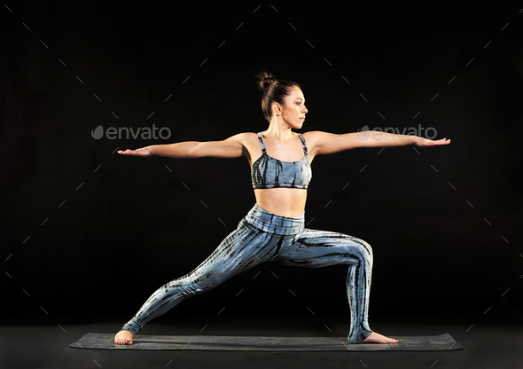 Woman demonstrating the warrior 2 pose in yoga - Stock Photo - Images
