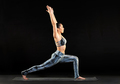 Woman practicing yoga doing a crescent lunge - PhotoDune Item for Sale