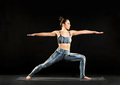 Woman demonstrating the warrior 2 pose in yoga - PhotoDune Item for Sale