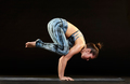 Woman demonstrating a crow pose in yoga - PhotoDune Item for Sale