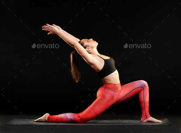 Fit woman demonstrating a low lunge pose - Stock Photo - Images