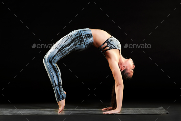 Supple woman demonstrating the wheel pose - Stock Photo - Images