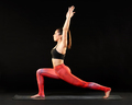 Woman practicing yoga doing a crescent lunge pose - PhotoDune Item for Sale
