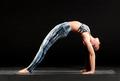 Woman demonstrating a straight legged wheel pose - PhotoDune Item for Sale