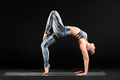 Fit healthy woman doing a one legged wheel pose - PhotoDune Item for Sale