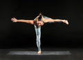 Woman doing balancing exercises during a workout - PhotoDune Item for Sale