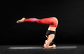 Muscular woman doing a headstand with pike legs - PhotoDune Item for Sale