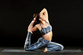 Young woman doing a mermaid or pigeon pose - PhotoDune Item for Sale