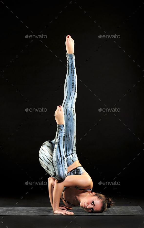 Supple woman demonstrating the fallen angel pose - Stock Photo - Images