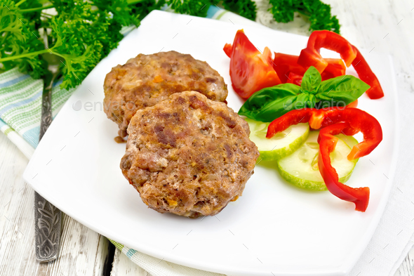 Cutlets stuffed with basil on light board - Stock Photo - Images